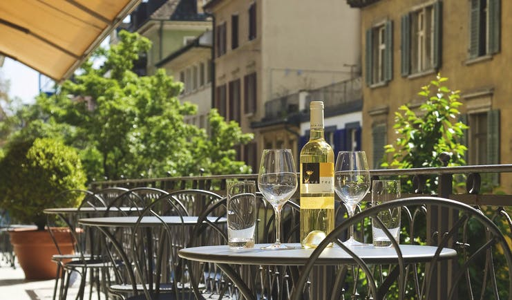 Hotel du Theatre Zurich lounge terrace on balcony with tables and wine