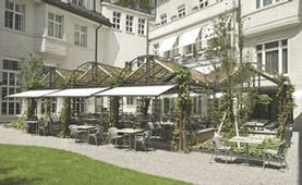 Hotel Glockenhof Zurich restaurant garden with covered terrace and plants