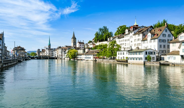 River Limmat in Zurich, white houses, traditional architecture, clock tower