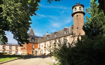 Chateau d'Isenbourg Alsace castle chateau building with grey roof and tower