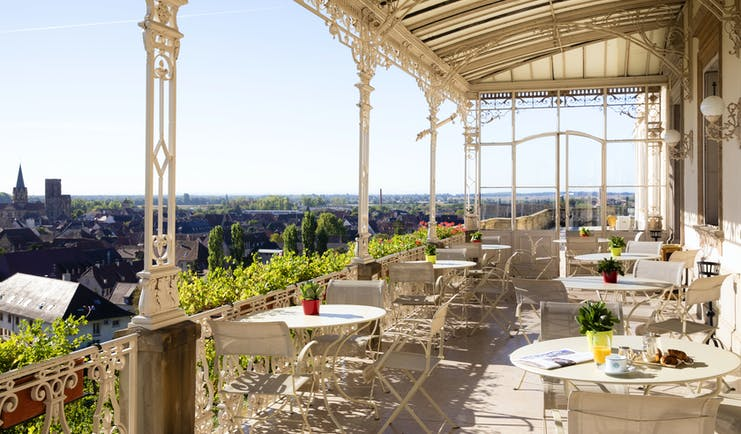 Chateau d'Isenbourg verandah with tables and view