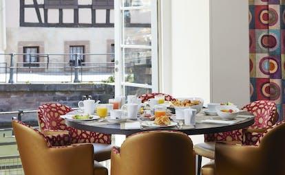 Breakfast table overlooking river at Regent Petite France