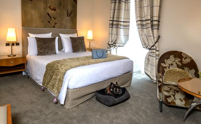 Deluxe bedroom at Regent Petite France creamy brown colours
