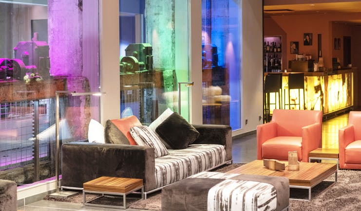 Regent Petite France lobby with lights of different colours and orange chairs