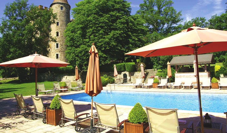 Chateau Codignat Auvergne outdoor pool with loungers surrounded by trees
