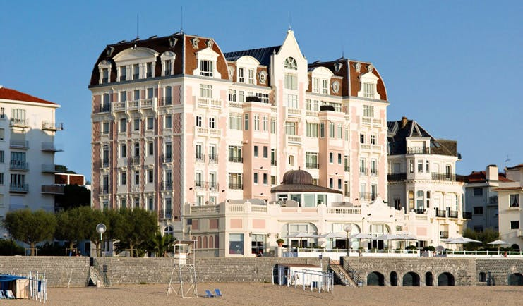 Grand Hotel Basque Country exterior pink building overlooking the beach