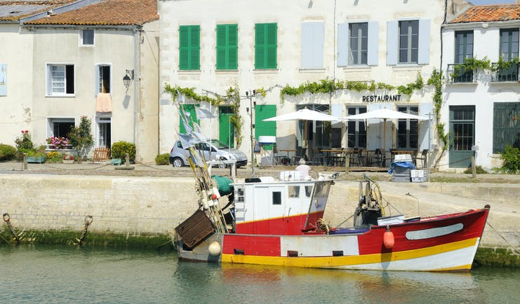Red and white fishing boat at harbour on Ile de Re