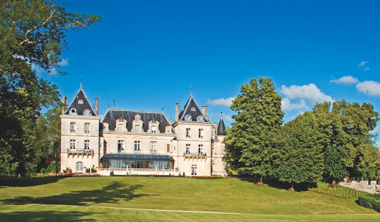 Chateau de Mirambeau exterior, grand hotel building, traditional chateau architecture, grass lawn, trees