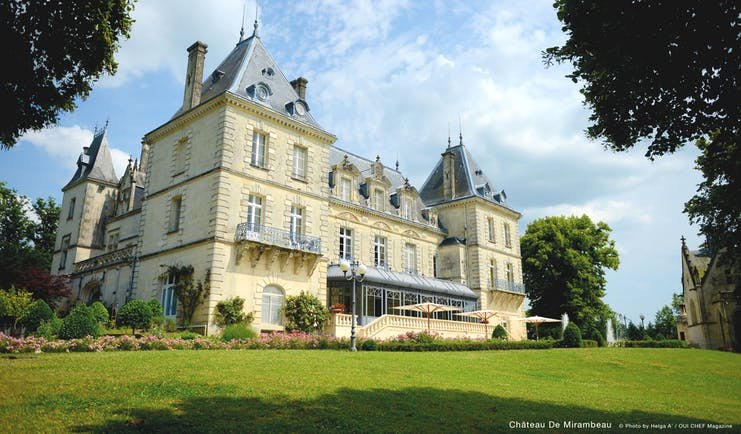 Chateau de Mirambeau hotel building, traditional chateau architecture, terrace, lawns