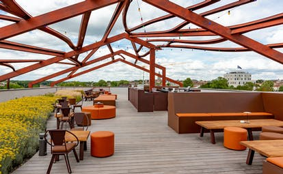 Roof terrace with wooden deck and low chairs Chais Monnet Cognac