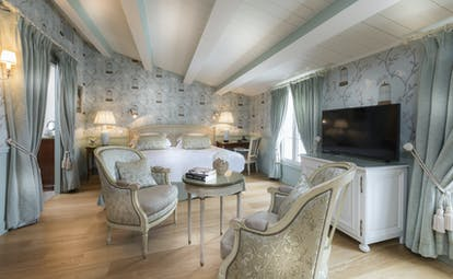 Hotel de Toiras pale blue green bedroom with wooden floor