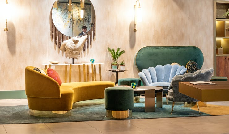 Le Burdigala Bordeaux lobby with hanging lights and yellow sofa