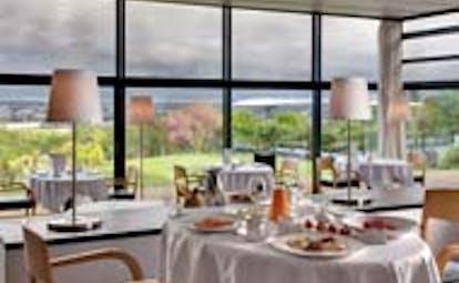 Le Saint James Bordeaux restaurant with large windows overlooking garden area