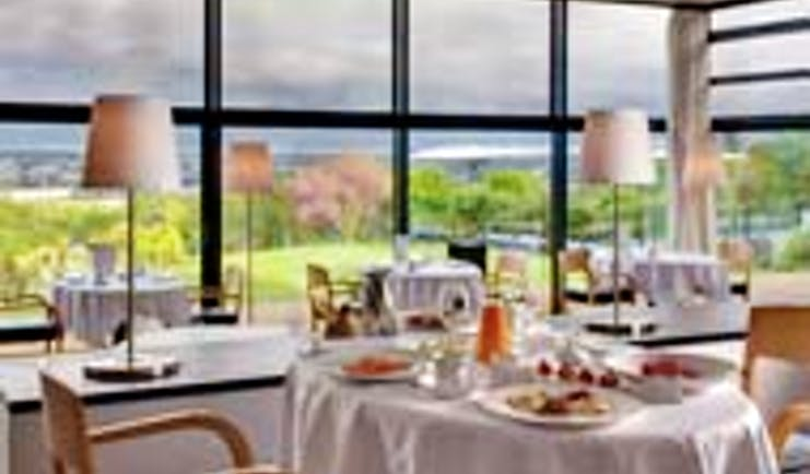 Le Saint James Bordeaux restaurant with large windows overlooking garden area