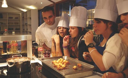 Cookery class with chef and pupils in chef hats