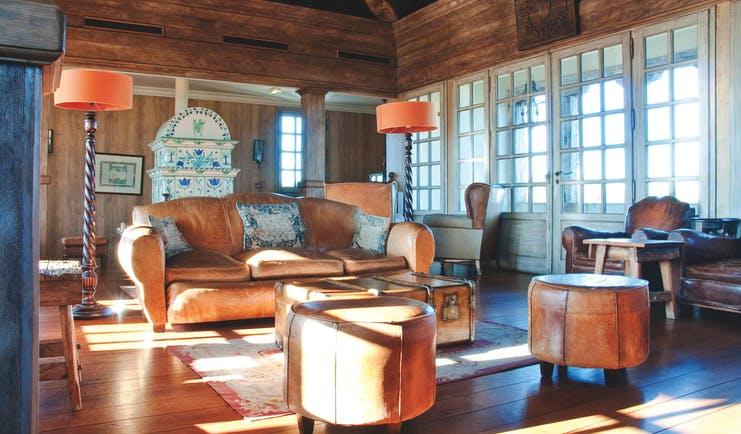 Wood pannelled lounge with old fashioned decor, leather sofas and a grand father clock