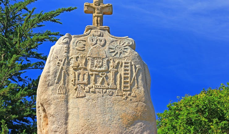 Menhir stone with cross on top in Brittany