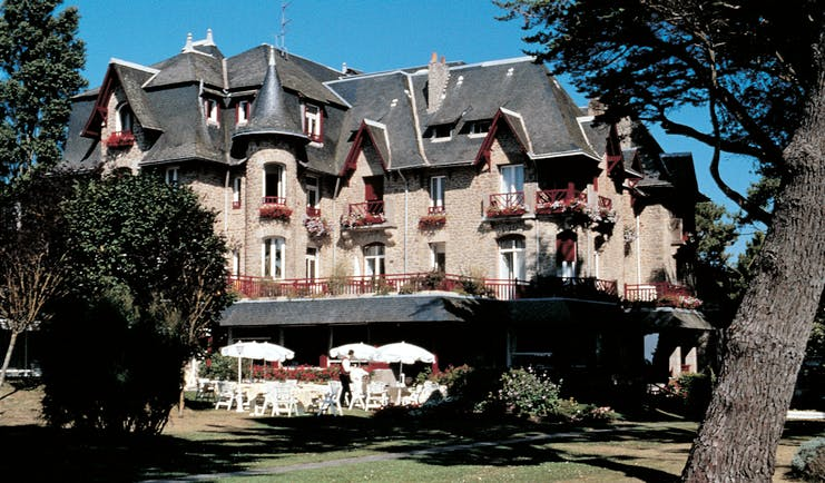 Castel Marie Louise Brittany exterior building with grey roof and view of gardens and outdoor dining area