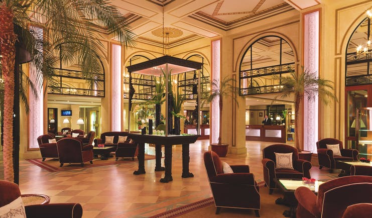 Hotel Hermitage Barriere Brittany lobby area with palm trees and armchairs