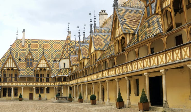 Tiled roof and turrets of the Hospices to Beaune in Burgundy