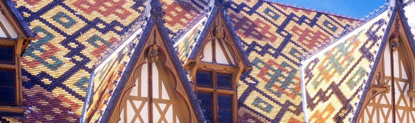 Multi coloured tiles of the roof of the Hospices in Beaune Burgundy