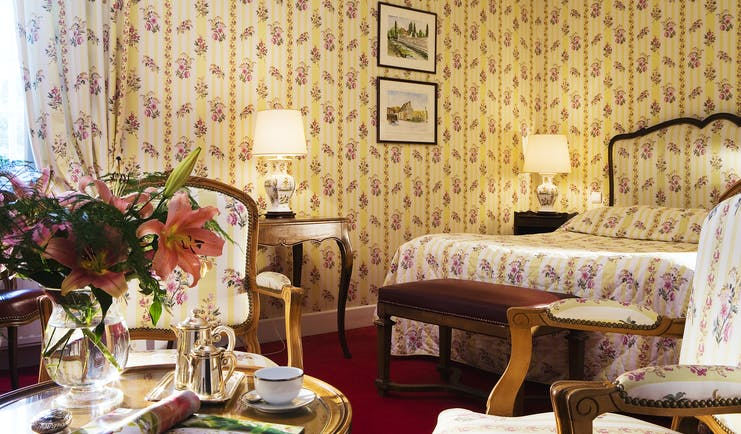 Chateau Gilly Burgundy classic bedroom with yellow and white floral striped wallpaper