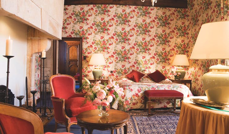 Chateau Gilly Burgundy junior terrace bedroom with floral wallpaper armchairs two bedside tables and lamps