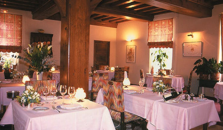 Le Montrachet Burgundy restaurant indoor dining area with exposed wooden beams