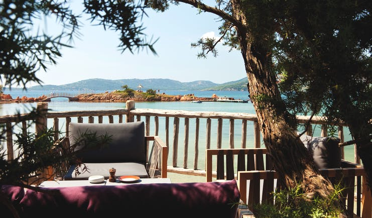 Grand Hotel de Cala Rossa Corsica bar seated terrace area overlooking the beach and small island