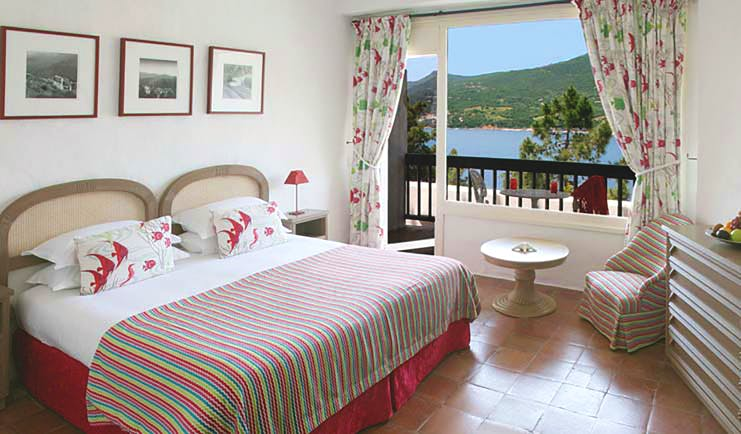 Miramar Boutique Hotel Corsica comfort bedroom tiled floors desk and chair window with sea view