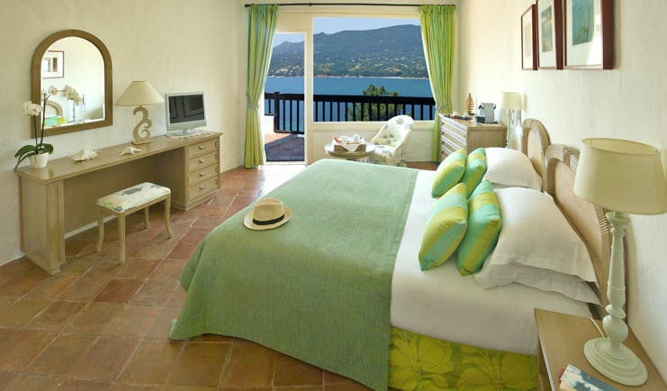 Miramar Boutique Hotel Corsica superior bedroom with tiled floors desk table chair and sea view