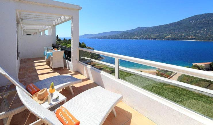Miramar Boutique Hotel Corsica terrace balcony with sun loungers and sea view