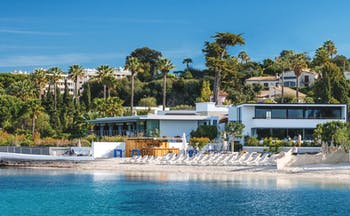 Le Cap d'Antibes Beach Hotel Cote d'Azur beach outdoor sun loungers and umbrellas in front of a white building
