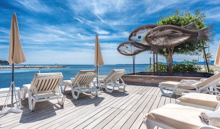 Le Cap d'Antibes Beach Hotel Cote d'Azur decking terrace sun loungers sculptures of fish