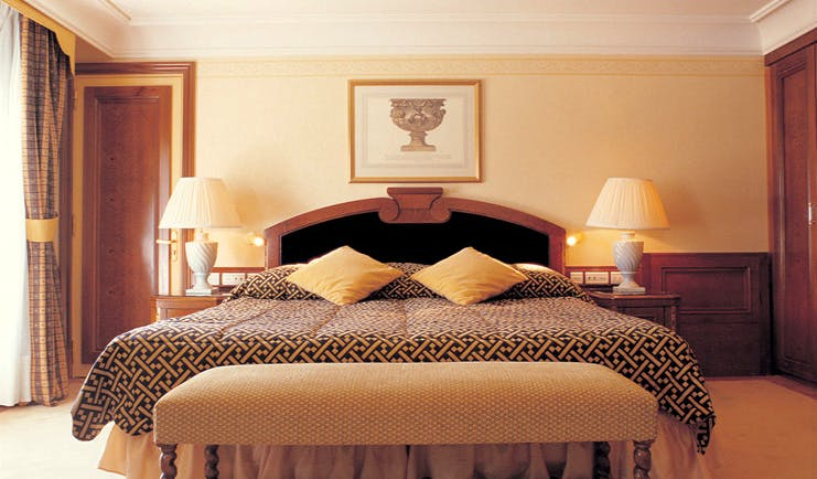 Grand Hotel du Cap Ferrat Cote d'Azur bedroom with ottoman and bedside tables