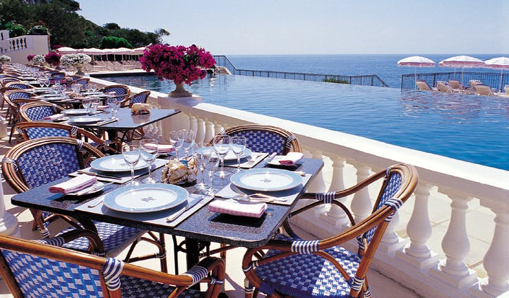 Grand Hotel du Cap Ferrat Cote d'Azur terrace dining area sea and pool view