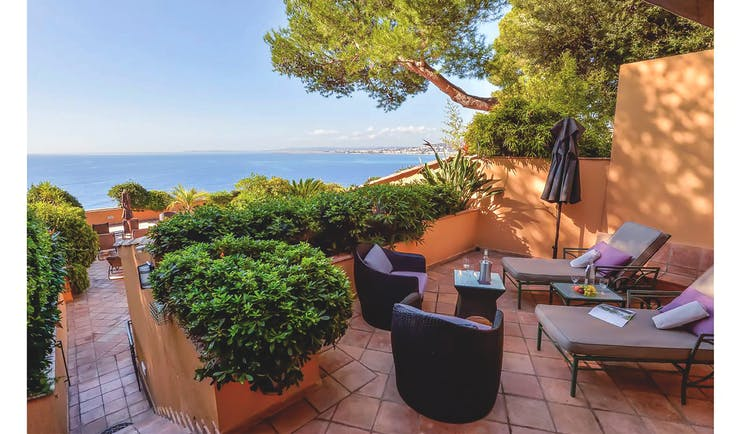 Hotel La Perouse Nice terrace patio walled terrace with two sun loungers a small table and two chairs