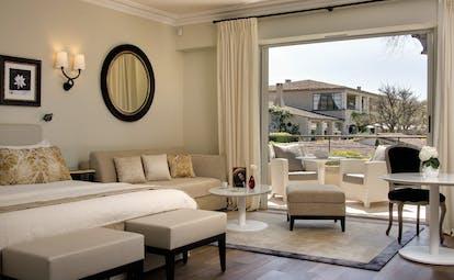 Le Mas de Pierre Cote d'Azur junior suite bedroom sofa tables and balcony view