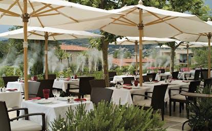 Le Mas de Pierre Cote d'Azur seated terrace outdoor dining area with large umbrellas