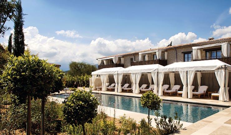 Le Mas de Pierre Cote d'Azur swimming pool outdoor sun loungers with white cabanas