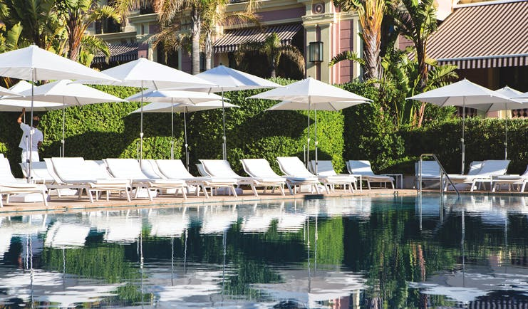 Royal Riviera Cote d'Azur exterior pool with sun loungers and umbrellas