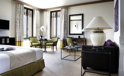 Royal Riviera Cote d'Azur junior suite sea bedroom lounge area with sofa