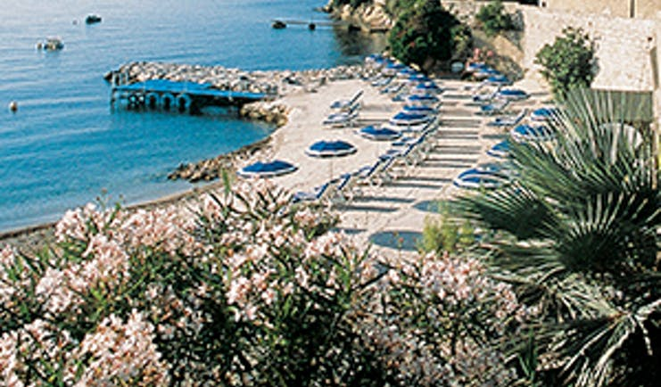 Royal Riviera Cote d'Azur private beach area with sun loungers and umbrellas