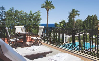 Royal Riviera Cote d'Azur suite balcony wrought iron fence sun loungers table and chairs