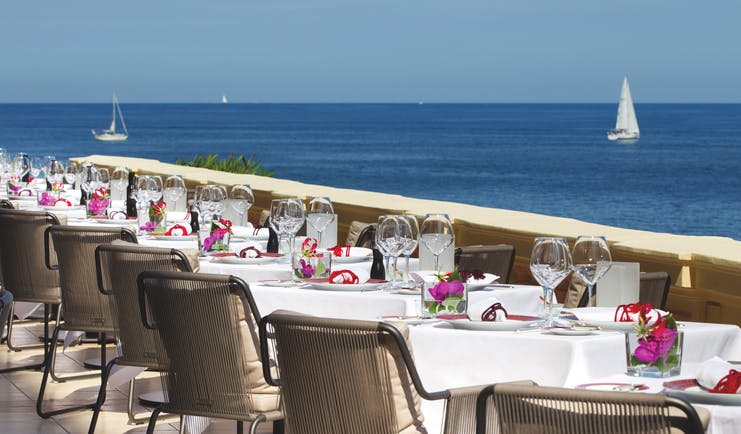 Royal Riviera Cote d'Azur sea view terrace tables with wine glasses