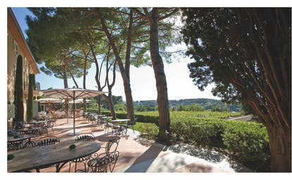 Le Mas Candille Cote d'Azur outdoor terrace with seating area looking out over countryside
