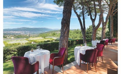 Le Mas Candille Cote d'Azur terrace with dining area overlooking the countryside