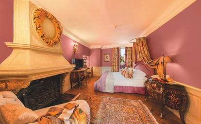 Le Saint Paul Cote d'Azur pink bedroom with fireplace