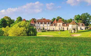 Chateau des Vigiers Dordogne exterior large building with golf course in front
