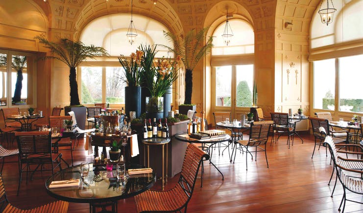 Hotel Royal Alps restaurant with palm trees
